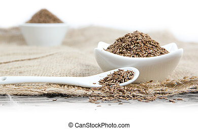 Cumin - Photo of bowls and spoon full of cumin with white...