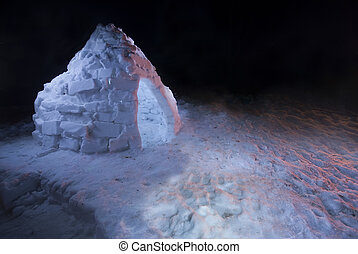 Homemade igloo lit up at night in front yard