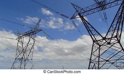 electrical pylons and clouds - time lapse of electric pylons...