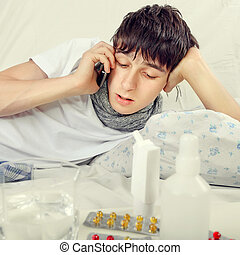 Sick Young Man - Toned Photo of Sick Young Man talk on...