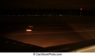 Aircraft take off in airport at night. Wings.
