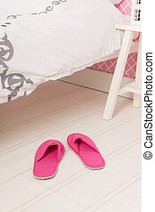 Slippers under the bed - Pink slippers under the bed in...