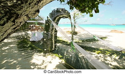 wedding ceremony in Seychelles - hawaiian decor with palm...