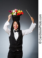 Woman with flowers in hat