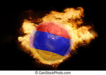football ball with the flag of armenia on fire - football...