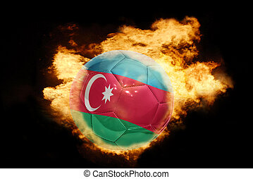 football ball with the flag of azerbaijan on fire - football...