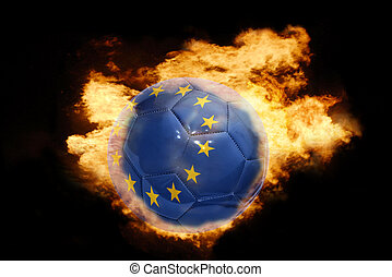 football ball with the flag of european union on fire -...