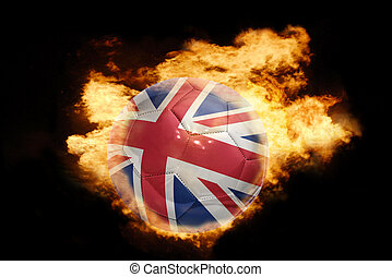 football ball with the flag of great britain on fire -...