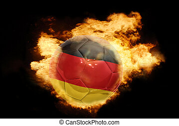 football ball with the flag of germany on fire - football...