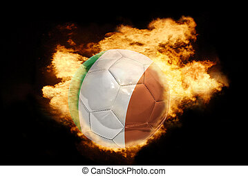 football ball with the flag of ireland on fire - football...