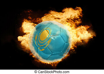 football ball with the flag of kazakhstan on fire - football...