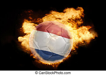 football ball with the flag of netherlands on fire -...