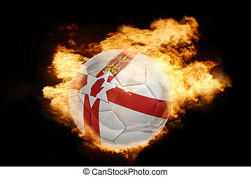 football ball with the flag of northern ireland on fire -...