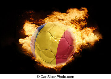 football ball with the flag of romania on fire - football...