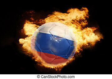 football ball with the flag of russia on fire - football...