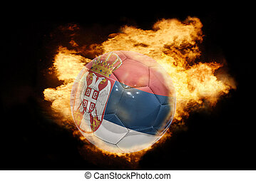 football ball with the flag of serbia on fire - football...