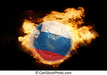 football ball with the flag of slovenia on fire - football...