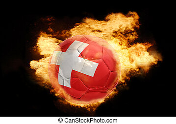 football ball with the flag of switzerland on fire -...