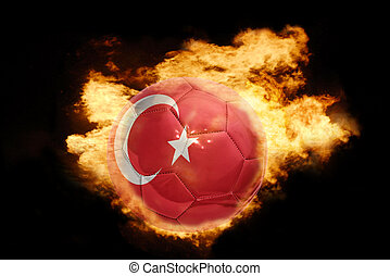 football ball with the flag of turkey on fire - football...
