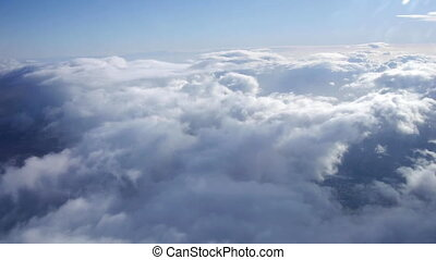 flying through the clouds - view from a plane flying above...