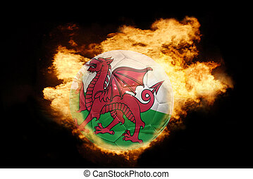 football ball with the flag of wales on fire - football ball...