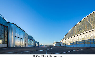 The area between aircraft hangars. Buildings are large and...