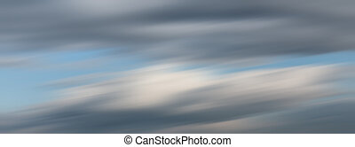 Defocused natural sky background with motion blur