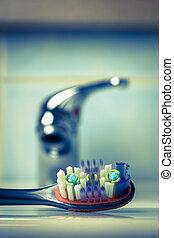 toothbrush in bathroom on sink
