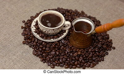 Turkish coffee and coffee beans - Pouring Turkish coffee and...