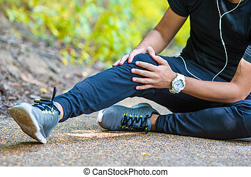 Male athlete suffering from pain in leg while exercising...