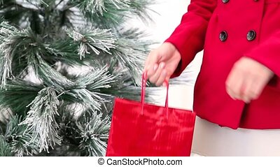Christmas hands woman with red bag,