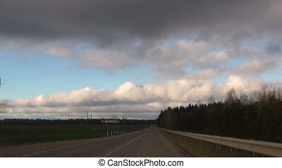 View from vehicle driving on country road - View from...