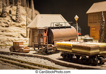 Station chocolate - a train station with houses, cars and...