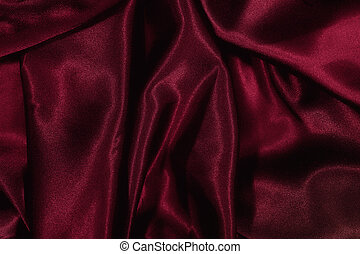 Texture of burgundy satin silk close up