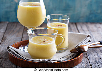 Mango smoothie with saffron in three different glasses