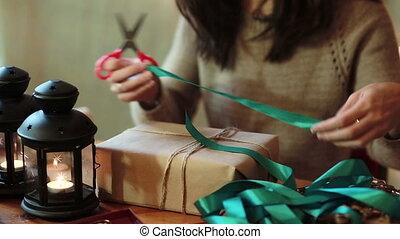 Womens Hands Wrapping Christmas Gifts At Home - Young Woman...