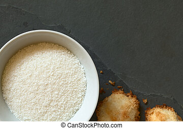 Grated Coconut - Grated coconut in bowl with coconut...