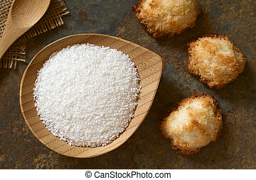 Grated Coconut - Grated coconut on small plate with coconut...