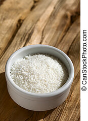 Grated Coconut - Grated coconut in small on wood,...