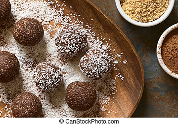 Coconut Rum Balls - Coconut rum balls being covered with...