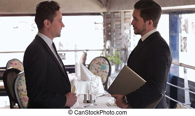The men shake each other hands - Business lunch in a...