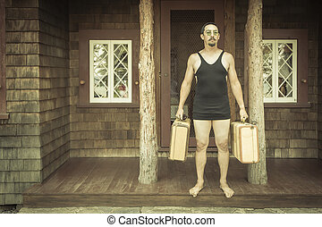 Gentleman Dressed in 1920's Era Swimsuit Holding Suitcases on Porch