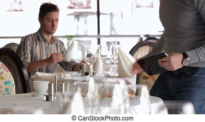 Casual dressed young businessman eating
