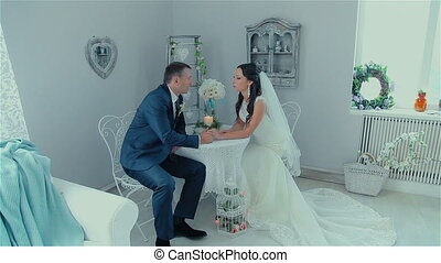 just married couple talking at the table HD