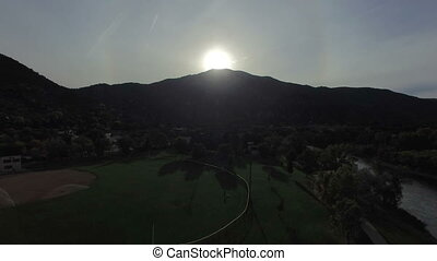 Video of sun rising above mountain - Slow mo video of a...