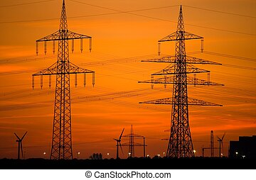 Power Lines and Wind Turbines at Sunset