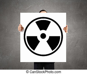 Radioactivity problem Concept image - Businessman showing...