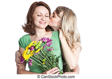Mother and daughter celebrating mothers day - A portrait of...