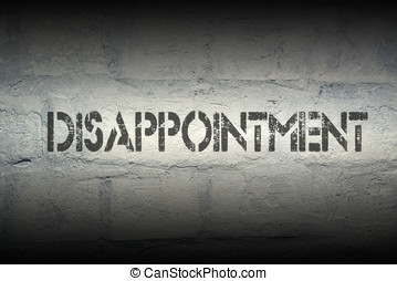 disappointment stencil print on the grunge white brick wall...