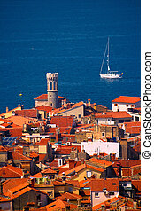 Sailboat and Roofs - Roofs of a typical town in Southern...